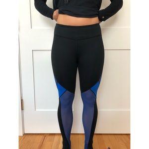 Fabletics black leggings with blue mesh
